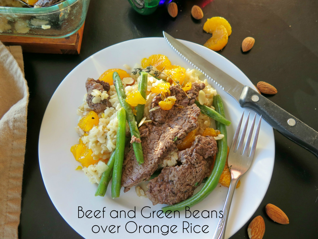 Beef and Beans Over Orange Rice plate