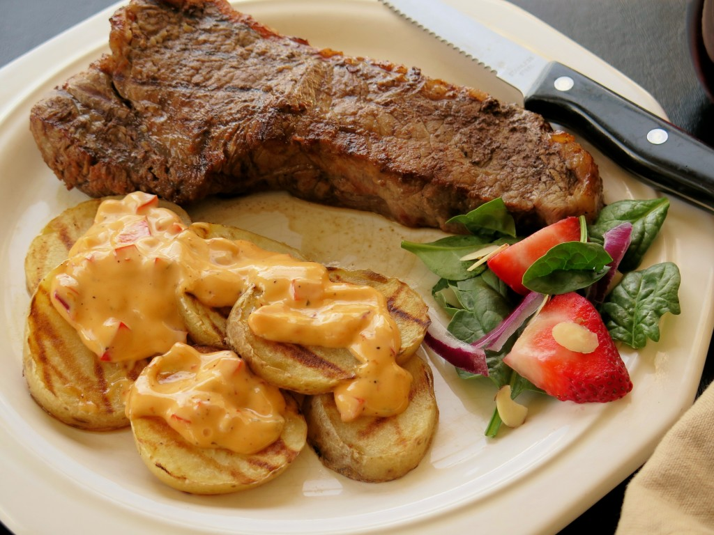 Tangy Tomato Chai Steaks with Saucy Grilled Spuds
